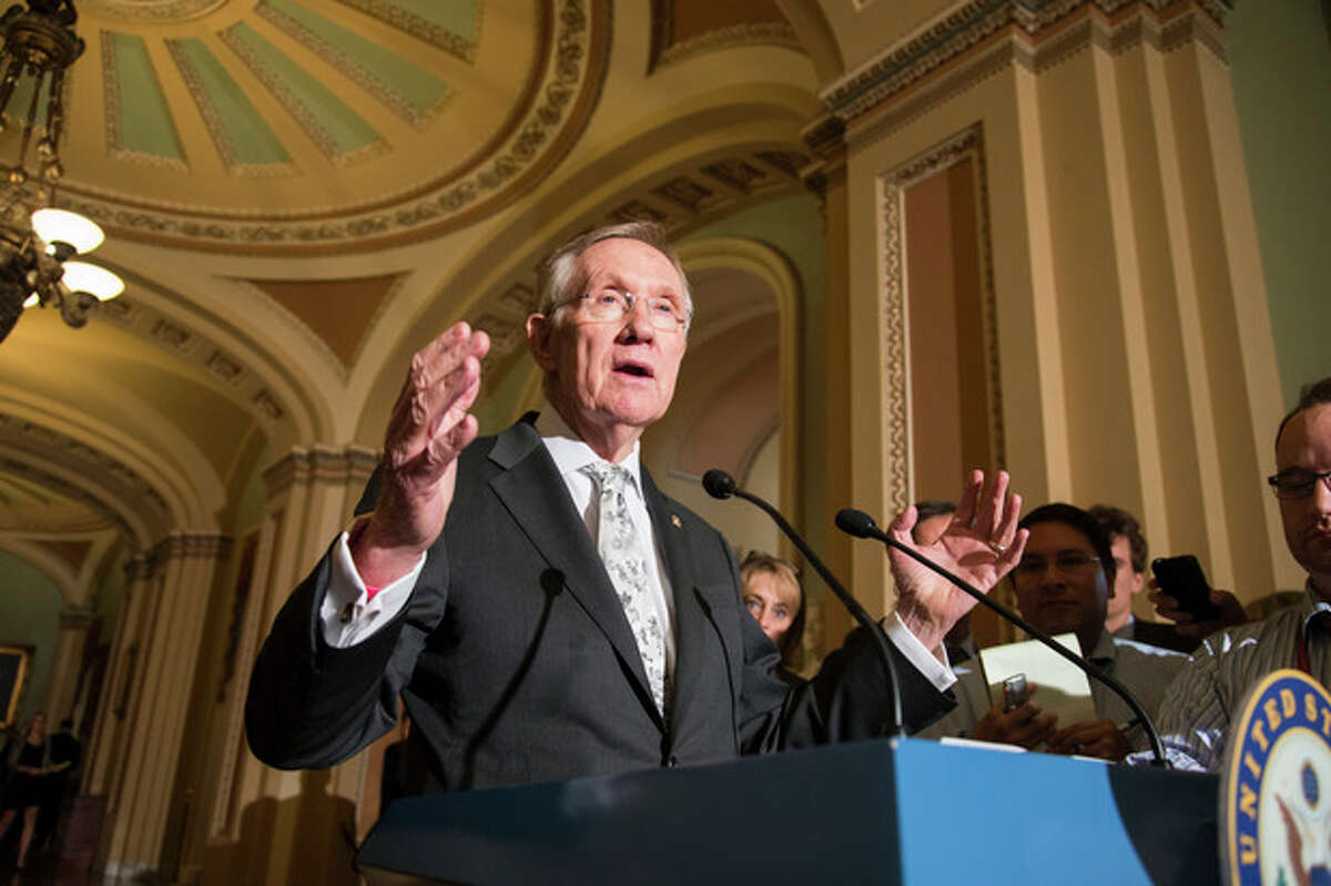 """Senate Majority Leader Harry Reid, D-Nev., speaks to reporters following a Democratic caucus at the Capitol in Washington, Tuesday, Sept. 17, 2013. Reid claims that Republican opposition to the Affordable Care Act, popularly known as Obamacare, has become obsessive, causing Congress to veer closer to gridlock. Reid said, """"The anarchists have taken over,"""" referring in less-than-friendly terms to Republicans with tea party ties. """"They've taken over the House. Now they're here in the Senate."""" (AP Photo/J. Scott Applewhite)"""