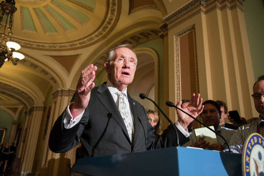 "Senate Majority Leader Harry Reid, D-Nev., speaks to reporters following a Democratic caucus at the Capitol in Washington, Tuesday, Sept. 17, 2013. Reid claims that Republican opposition to the Affordable Care Act, popularly known as Obamacare, has become obsessive, causing Congress to veer closer to gridlock. Reid said, ""The anarchists have taken over,"" referring in less-than-friendly terms to Republicans with tea party ties. ""They've taken over the House. Now they're here in the Senate."" (AP Photo/J. Scott Applewhite) / AP"