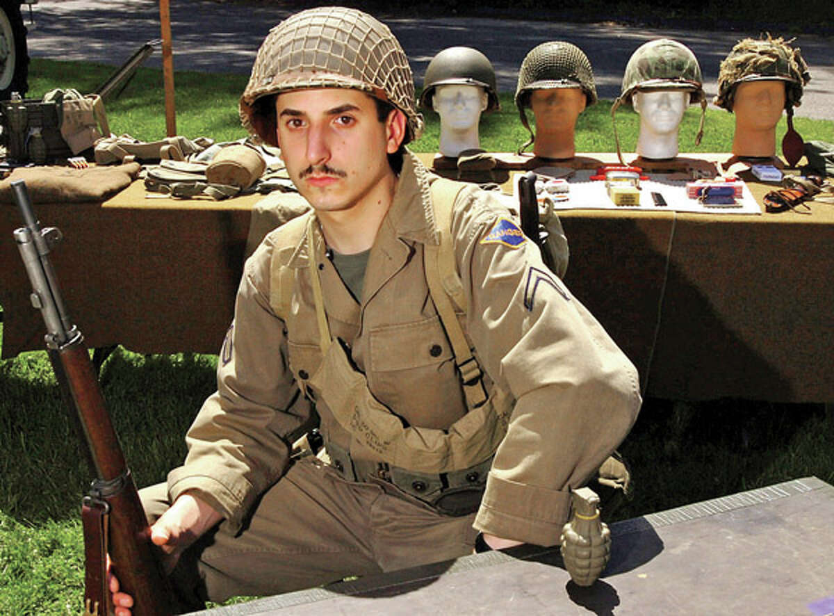 Joe Sabia, a WWll re enactor, poses an army ranger during the American Legion Frank C. Godfrey Post 12 Weekend at the Post event Saturday. Hour photo / Erik Trautmann
