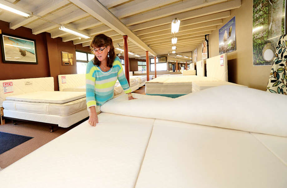 Annie Chester sells mattresses at Norwalk Mattress Co. on West Cedar St. in Norwalk. Norwalk Mattress has been manufacturing mattresses in Norwalk since 1918. Hour photo / Erik Trautmann