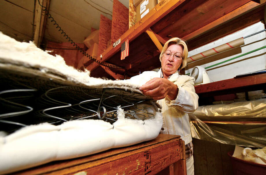 Norwalk Mattress Co. co-owner Pat Drew describes how the mattresses are made at their West Cedar St. facility in Norwalk. Norwalk Mattress has been manufacturing mattresses in Norwalk since 1918. Hour photo / Erik Trautmann
