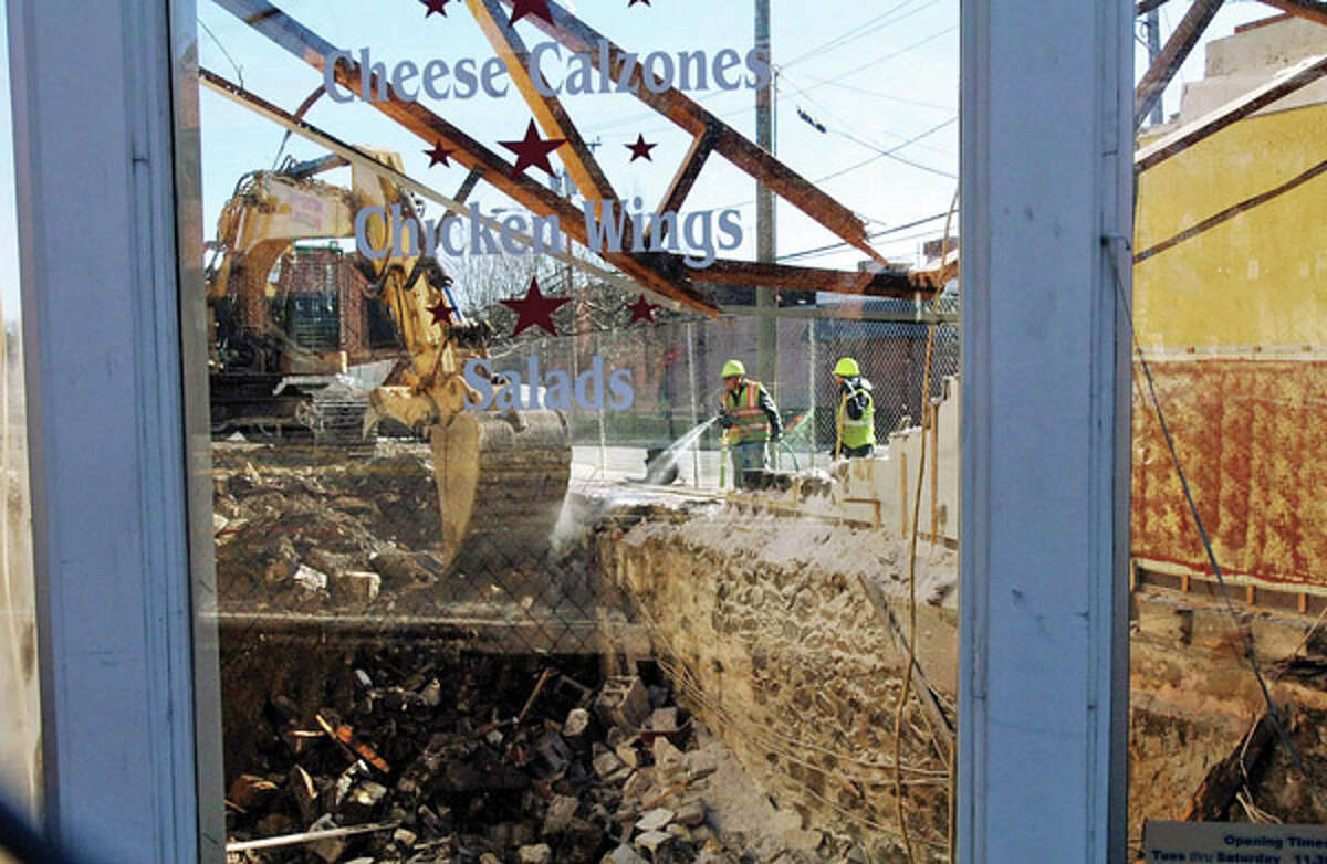 Demolition continues at the former location of Sonny's Pizza at 501 West Ave. in preparation for the Waypointe redeveloment project. the Hour photo / Erik Trautmann