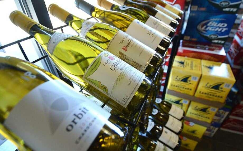 Hour Photo/Alex von Kleydorff White wines on a rack at the Wilton Wine Shoppe
