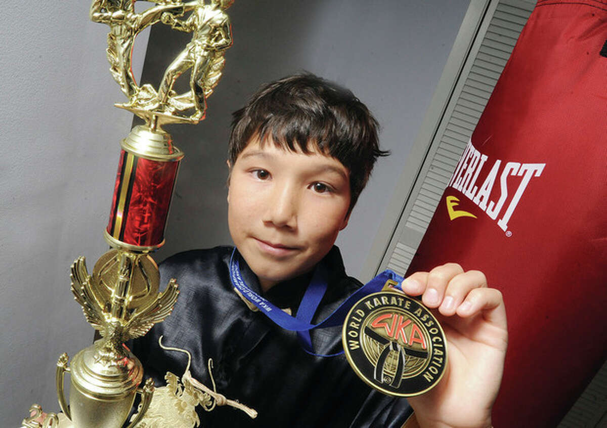 Photo by Matthew Vinci Twelve-year old Adrian Frank of Stamford is headed for the Kung Fu world championships later this fall in Crete, Greece.