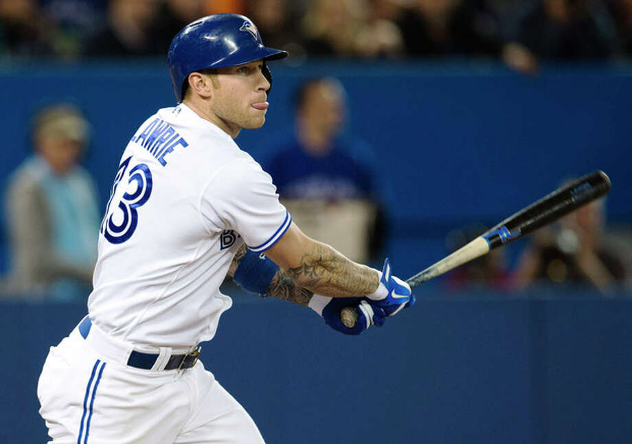 Toronto Blue Jays' Brett Lawrie hits a double against the New York Yankees during the fourth inning of MLB American League baseball action in Toronto Wednesday, Sept. 18, 2013. (AP Photo/The Canadian Press, Mark Blinch) / CP