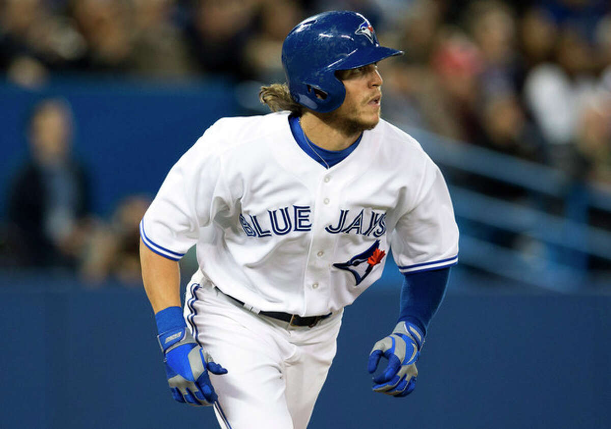 Toronto Blue Jays' Colby Rasmus watches his two run home run against the New York Yankees during the fourth inning of MLB American League baseball action in Toronto Wednesday, Sept. 18, 2013. (AP Photo/The Canadian Press, Mark Blinch)