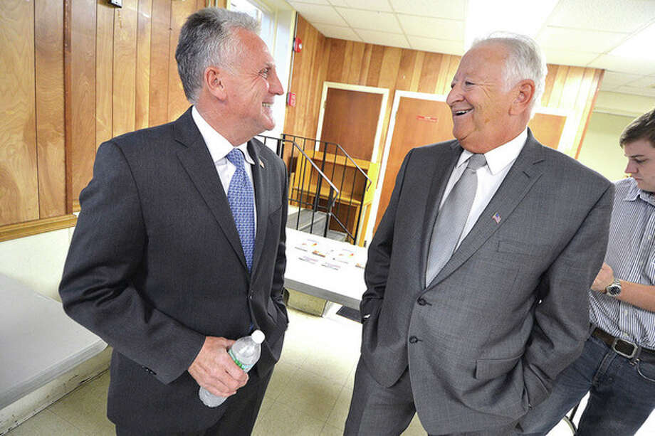 Hour Photo/Alex von Kleydorff Mayoral Candidate Harry Rilling and Mayor Richard Moccia talk before Meet the Candidates forum at The East Norwalk Library on Wednesday night.