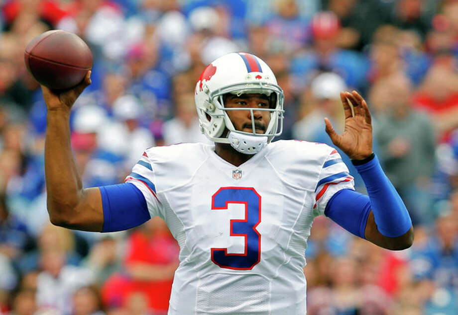 Buffalo Bills quarterback EJ Manuel passes against the Carolina Panthers in the third quarter of an NFL football game Sunday, Sept. 15, 2013, in Orchard Park, N.Y. (AP Photo/Bill Wippert) / FR170745 AP