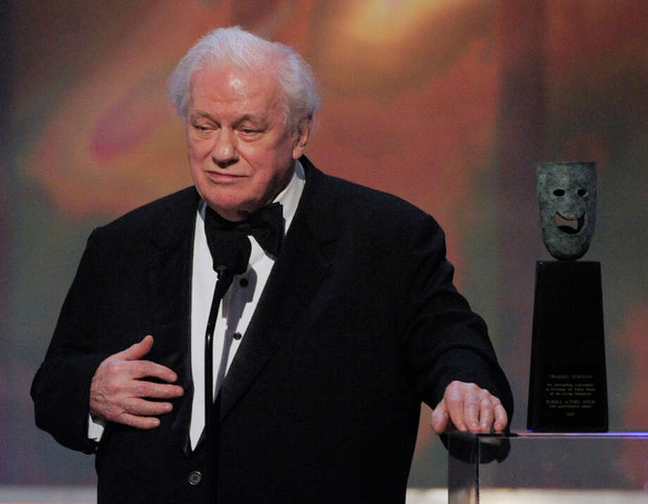 FILE - In this Sunday, Jan. 27, 2008 file photo, in Los Angeles file photo, actor Charles Durning accepts the life achievement award at the 14th Annual Screen Actors Guild Awards. Durning, the two-time Oscar nominee who was dubbed the king of the character actors for his skill in playing everything from a Nazi colonel to the pope, died Monday, Dec. 24, 2012 at his home in New York City. He was 89. (AP Photo/Mark J. Terrill) / AP