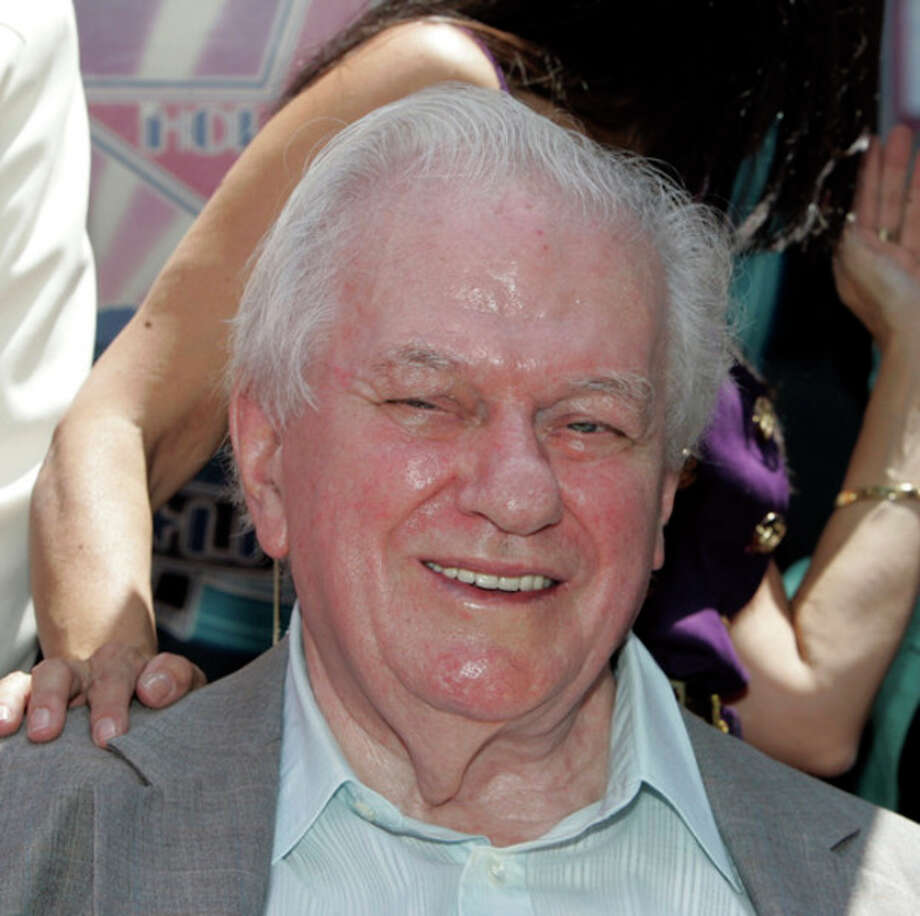 FILE - In this Thursday, July 31, 2008 file photo, actor Charles Durning smiles during ceremonies honoring him with a star on the Hollywood Walk of Fame in Los Angeles. Durning, the two-time Oscar nominee who was dubbed the king of the character actors for his skill in playing everything from a Nazi colonel to the pope, died Monday, Dec. 24, 2012 at his home in New York City. He was 89. (AP Photo/Reed Saxon) / AP