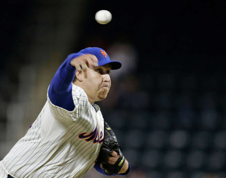 New York Mets starting pitcher Aaron Harang delivers against the San Francisco Giants in the first inning of a baseball game on Wednesday, Sept. 18, 2013, in New York. (AP Photo/Kathy Willens) / AP