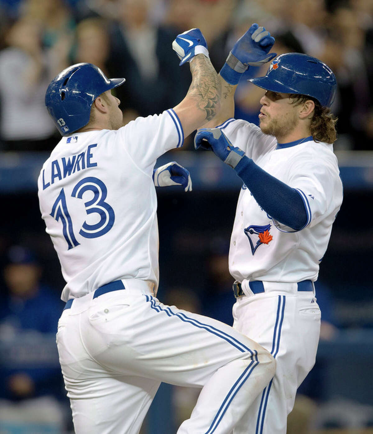 Toronto Blue Jays' Colby Rasmus, right, celebrates his two run home run against the New York Yankees with teammate Brett Lawrie during the fourth inning of MLB American League baseball action in Toronto Wednesday, Sept. 18, 2013. (AP Photo/The Canadian Press, Mark Blinch)