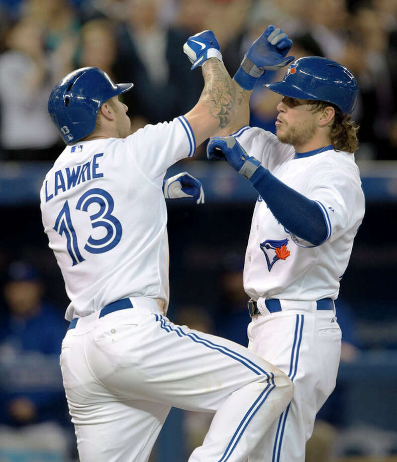 Toronto Blue Jays' Colby Rasmus, right, celebrates his two run home run against the New York Yankees with teammate Brett Lawrie during the fourth inning of MLB American League baseball action in Toronto Wednesday, Sept. 18, 2013. (AP Photo/The Canadian Press, Mark Blinch) / Canadian Press