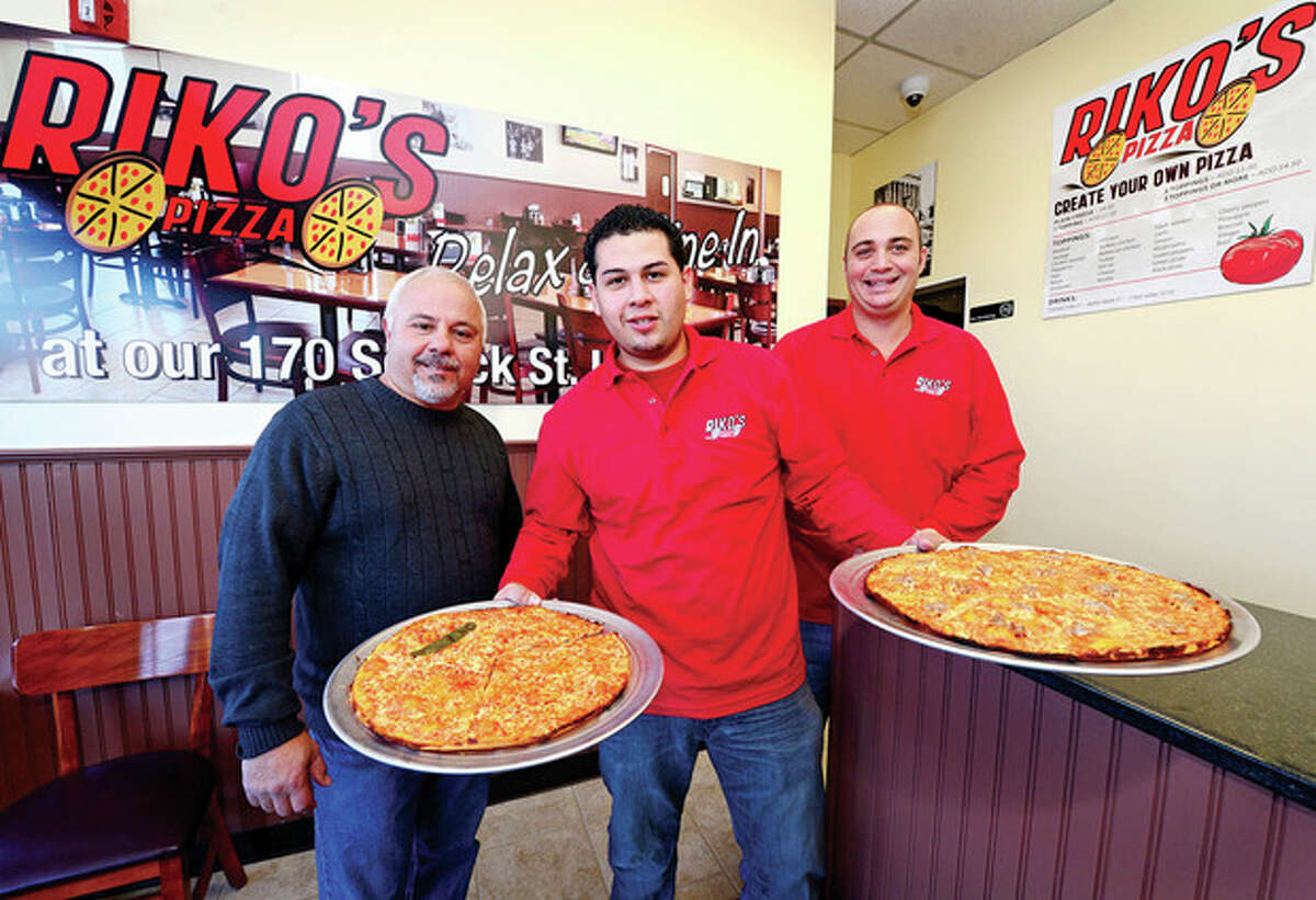 Co-owner of Riko's Pizza, Rico Imbrogno, Aaron Hernandez, co-owner Luigi Cardillo in their new Norwalk location on Main Ave. and Hour photo / Erik Trautmann