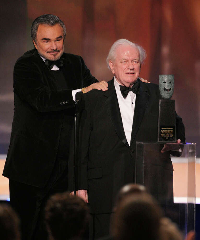 FILE - In this Sunday, Jan. 27, 2008 file photo, actor Charles Durning accepts the life achievement award from presenter Burt Reynolds, left, at the 14th Annual Screen Actors Guild Awards in Los Angeles. Durning, the two-time Oscar nominee who was dubbed the king of the character actors for his skill in playing everything from a Nazi colonel to the pope, died Monday, Dec. 24, 2012 at his home in New York City. He was 89. (AP Photo/Mark J. Terrill) / AP
