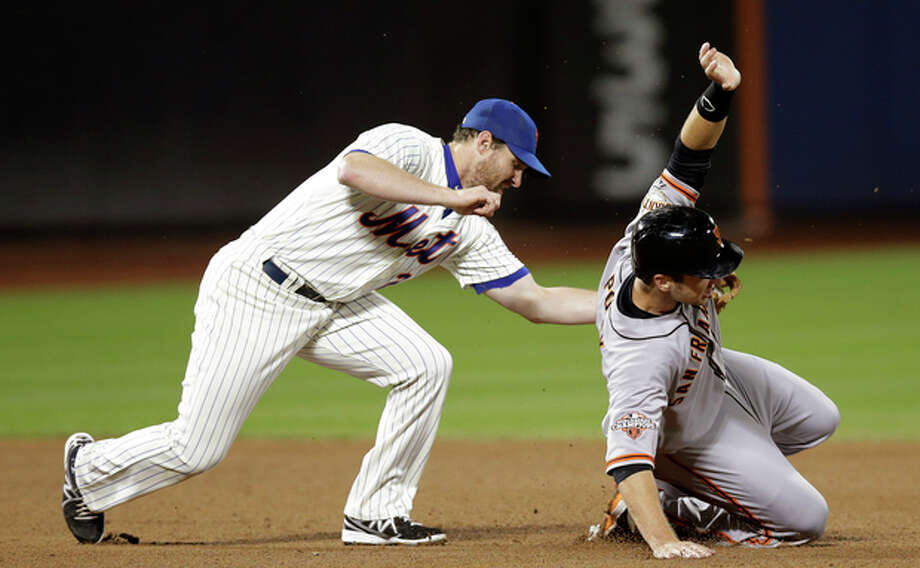 San Francisco Giants' Buster Posey, right, is safe stealing second as New York Mets second baseman Daniel Murphy, left, applies a late tag in the fifth inning of a baseball game on Wednesday, Sept. 18, 2013, in New York. AP Photo/Kathy Willens) / AP