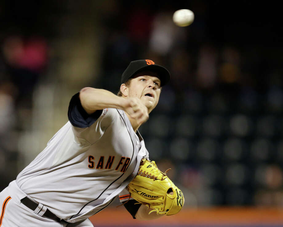 San Francisco Giants starting pitcher Matt Cain delivers against the New York Mets in the first inning of a baseball game on Wednesday, Sept. 18, 2013, in New York. (AP Photo/Kathy Willens) / AP