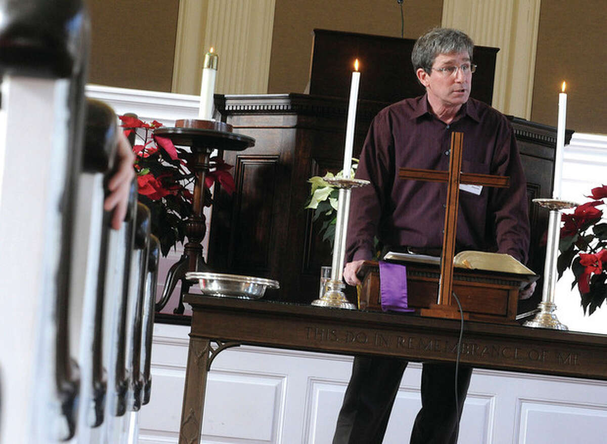 Nathaniel S. Yordon, chairman of the board of deacons at the First Congegational Church in Norwalk leads the sermon for the Christmas Day mass on Tuesday. hour photo/Matthew Vinci