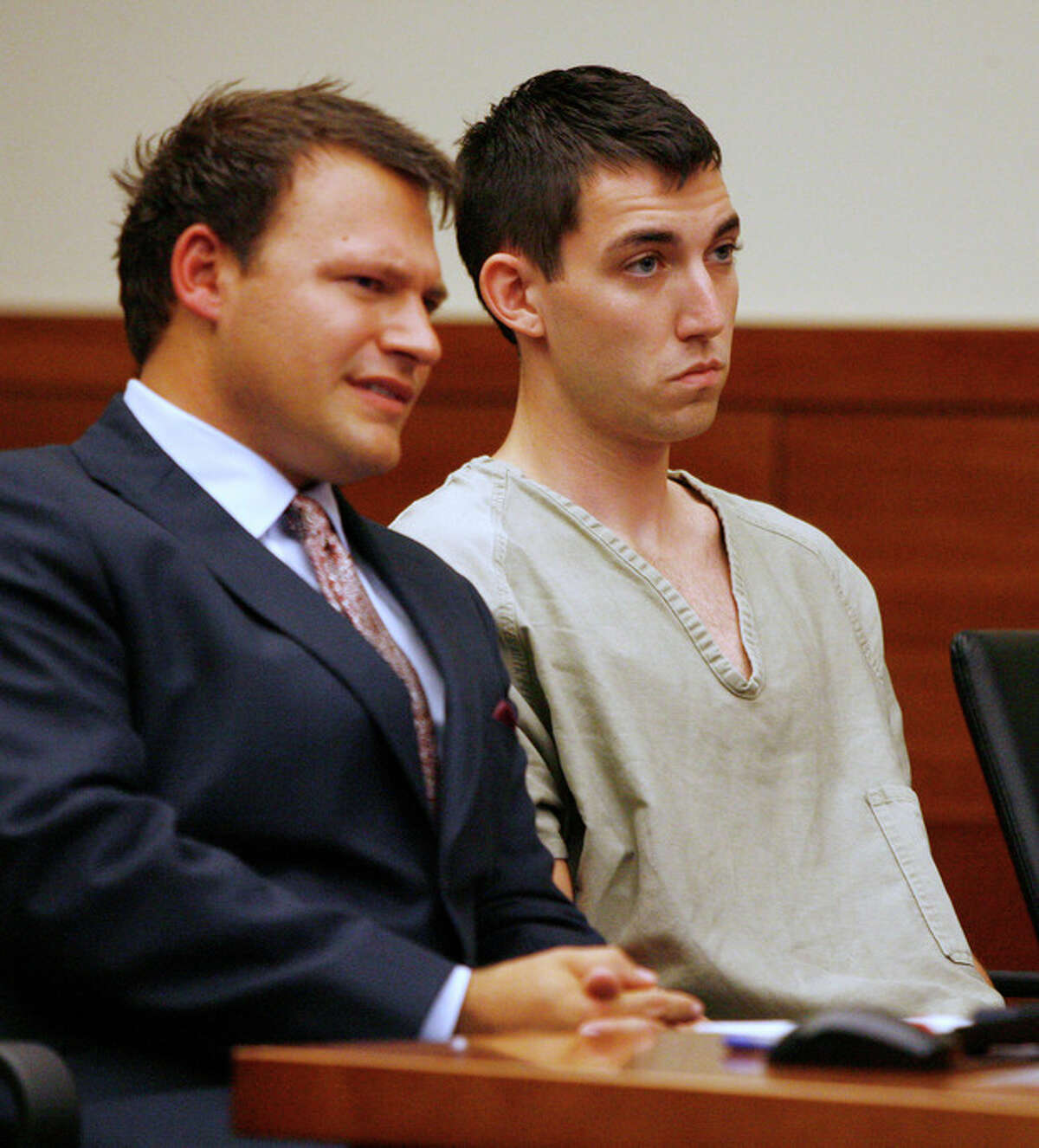 FILE- This Tuesday, Sept. 10, 2013, file photo shows Matthew Cordle, right, and his attorney, Martin Midian in court in Columbus, Ohio. Cordle, who confessed in an online video to causing a fatal wrong-way crash after a night of heavy drinking, will plead guilty to the crime on Wednesday, Sept 18, 2013, according to his attorneys. (AP Photo/Mike Munden, File)