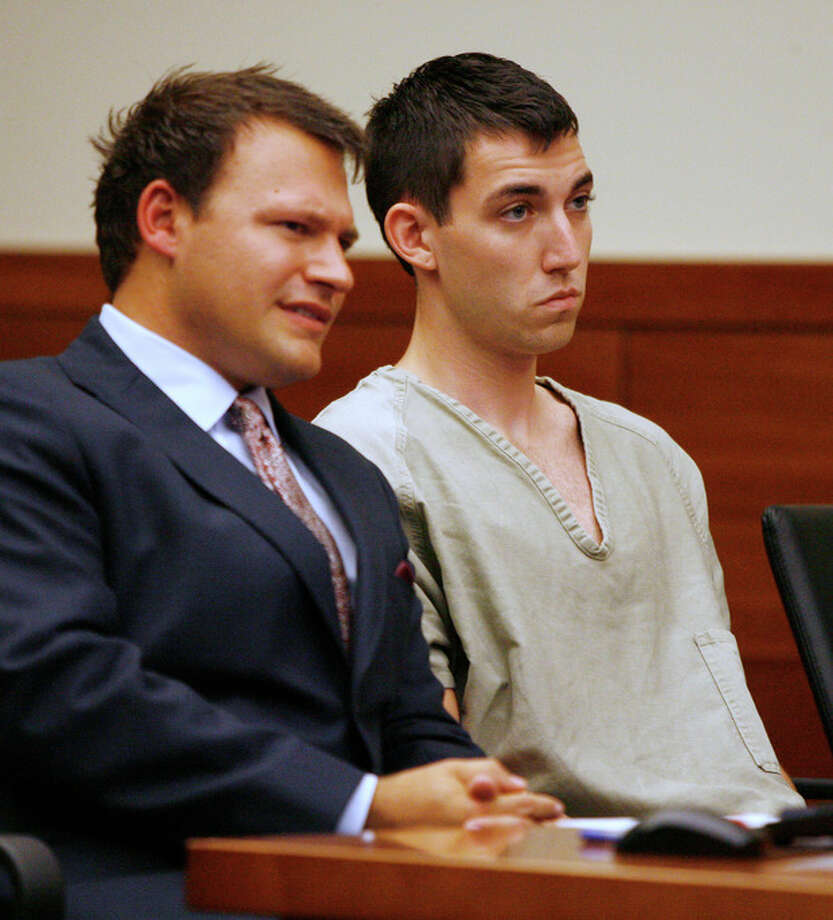 FILE- This Tuesday, Sept. 10, 2013, file photo shows Matthew Cordle, right, and his attorney, Martin Midian in court in Columbus, Ohio. Cordle, who confessed in an online video to causing a fatal wrong-way crash after a night of heavy drinking, will plead guilty to the crime on Wednesday, Sept 18, 2013, according to his attorneys. (AP Photo/Mike Munden, File) / FR57028 AP