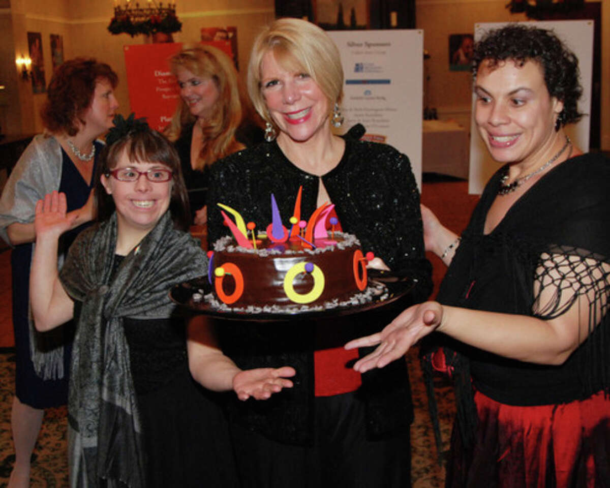 AP photo Cheryl Kennen, director of residential services at STAR, and Jassinia Mysogland and Nicole DuBiago, STAR clients, present the first month's dessert to the winner of the