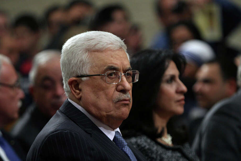 Palestinian President Mahmoud Abbas, attends Christmas Midnight Mass at Saint Catherine's Church in the West Bank town of Bethlehem, early Tuesday, Dec. 25, 2012. (AP Photo/Abed Al Hashlamoun, Pool) / EPA POOL