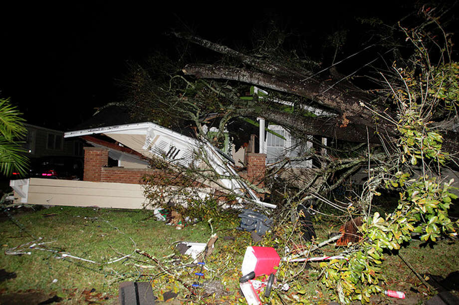 A house in the Midtown section of Mobile, Ala. is damaged after a tornado touched down Tuesday, Dec. 25, 2012. A Christmas Day twister outbreak left damage across the Deep South while holiday travelers in the nation's much colder midsection battled sometimes treacherous driving conditions from freezing rain and blizzard conditions. (AP Photo/AL.com, Mike Kittrell) MAGS OUT / AL.com