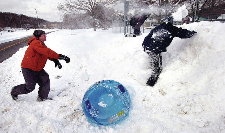 Photo/Alex von Kleydorff. After sledding with Friends Reid Melillo scores a direct hit with a snowball on their way to The Wilton Deli to warm up. / © 2010 The Hour Newspapers/Alex von Kleydorff