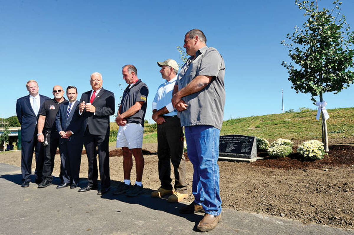 Councilman Davoid McCarthy, Councilman Jerry Petrini, State SEnator Bob Duff and Norwalk mayor Richard Moccia thank Southgate Nuserymen Landscape Contractors Michael DiNello, Jim Lorusso and Robert Barone who donated 26 trees and a stone plaque to honor the victims of the Sandy Hook shooting during a brief ceremony at Norwalk's Oyster Shell Park Thursday morning. Hour photo / Erik Trautmann