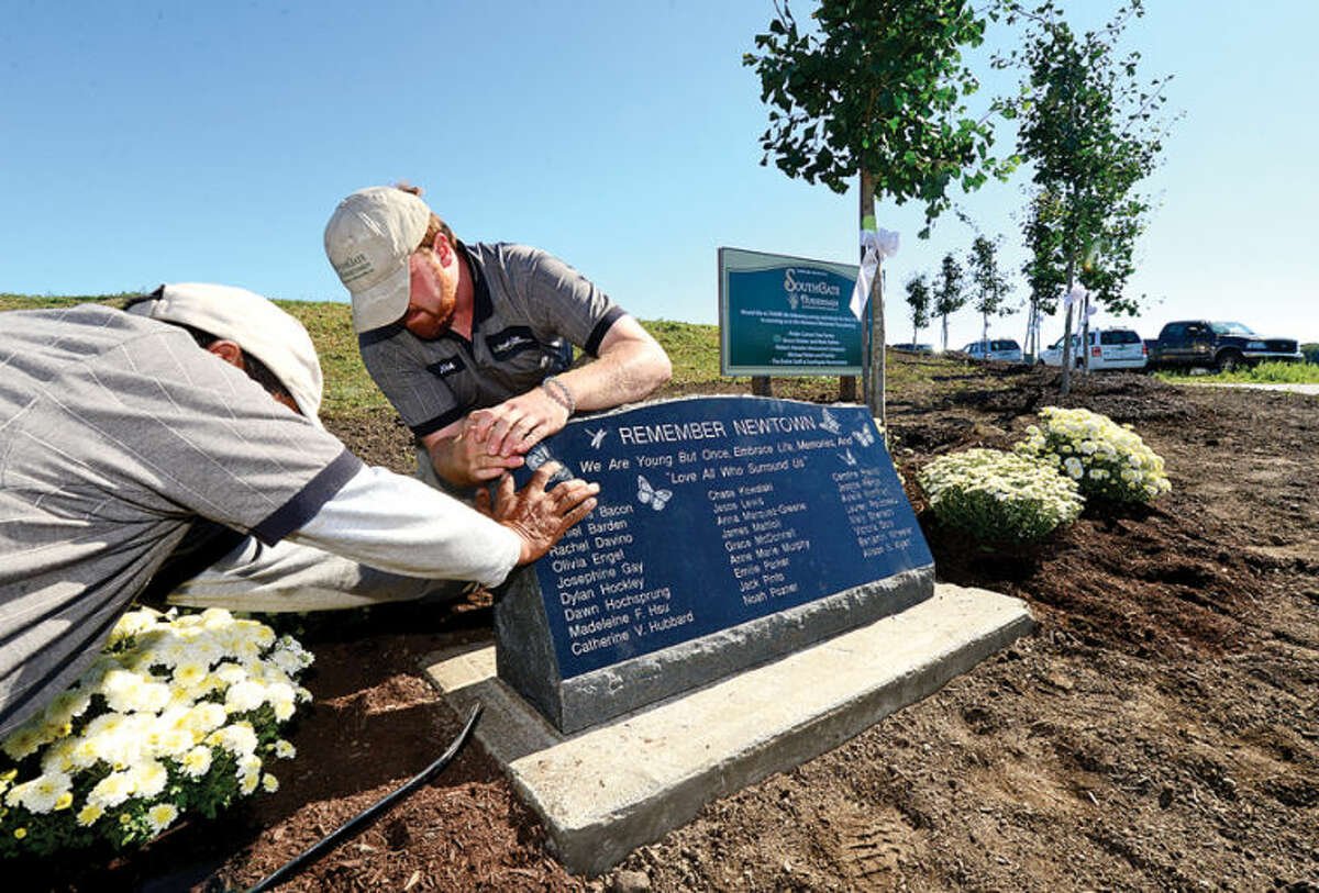 Southgate Nuserymen Landscape Contractors donate 26 trees and a stone plaque to honor the victims of the Sandy Hook shooting during a brief ceremony at Norwalk's Oyster Shell Park Thursday morning. Hour photo / Erik Trautmann