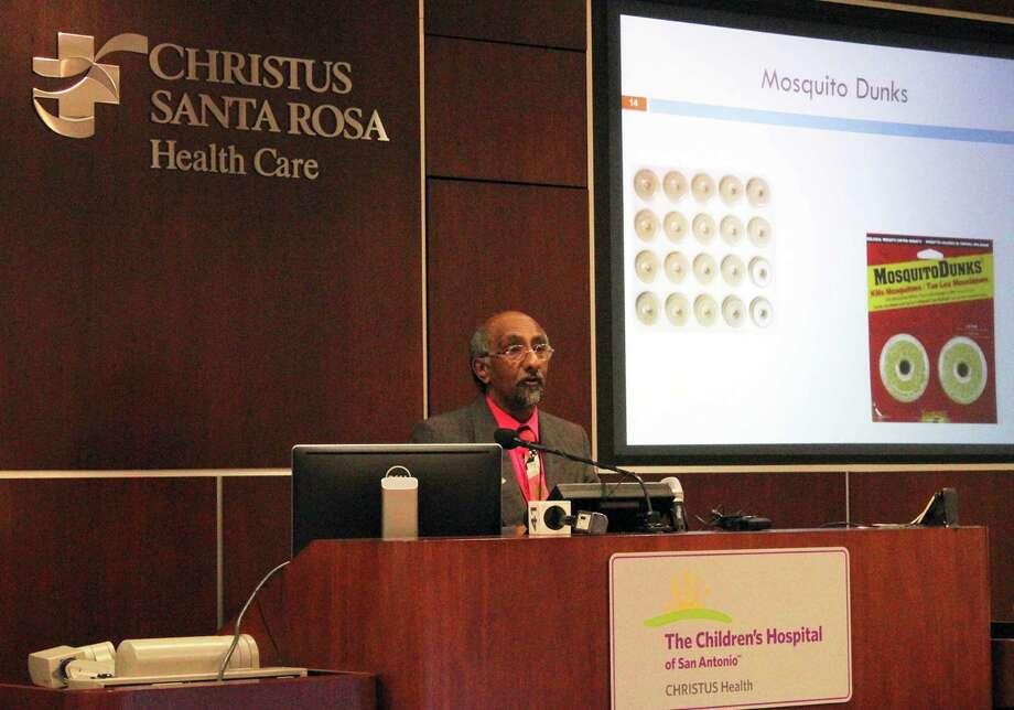 Dr. Anil Mangla,   of San Antonio Metropolitan Health District, discusses halting   the Zika virus at a Wednesday symposium. Photo: Kate Carlson / San Antonio Express-News / San Antonio Express-News