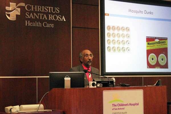 Dr. Anil Mangla,   of San Antonio Metropolitan Health District, discusses halting   the Zika virus at a Wednesday symposium.