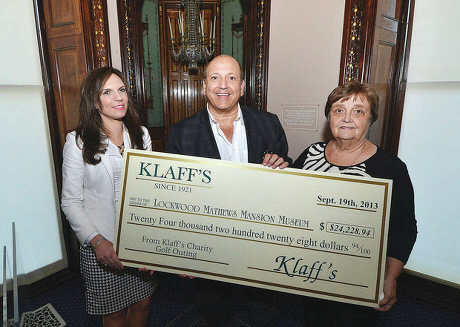 Hour Photo/Alex von Kleydorff Joe Passero Preident and COO of Klaffs presents a check to Lockwood Matthews Mansion Executive Director Susy Gilgore and Patsy Brescia, Chairman of the Board of Trustees.