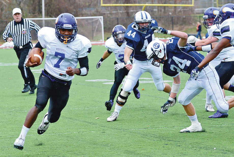 # 7 Davell Caterell of Westhill runs for a TD during their game against Wilton Saturday in Stamford. / (C)2012, The Hour Newspapers, all rights reserved