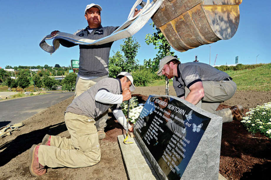 Southgate Nuserymen Landscape Contractors donate 26 trees and a stone plaque to honor the victims of the Sandy Hook shooting during a brief ceremony at Norwalk's Oyster Shell Park Thursday morning.Hour photo / Erik Trautmann / (C)2013, The Hour Newspapers, all rights reserved