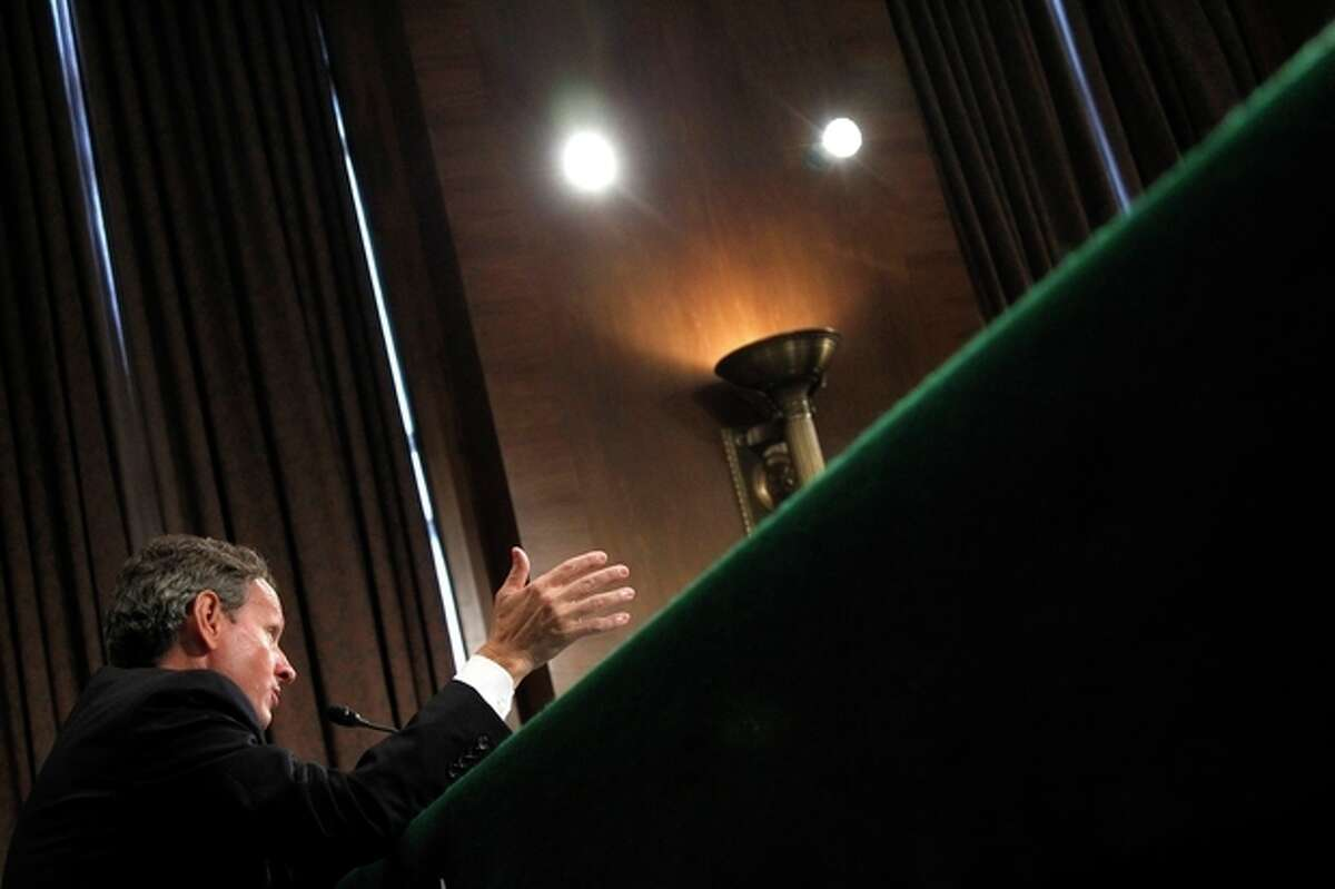 FILE - In this Thursday, July 26, 2012, file photo,Treasury Secretary Timothy Geithner testifies on Capitol Hill in Washington, before the Senate Banking Committee hearing: