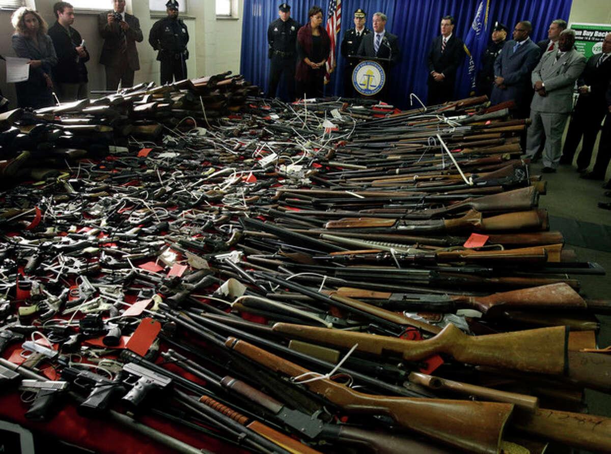 AP photo Guns cover tables in front of Camden Mayor Dana Redd, center left, and New Jersey Attorney General Jeffrey Chiesa, center at podium, in Camden, N.J., as they announce last weekend's gun buyback event brought in more than 1,100 guns.