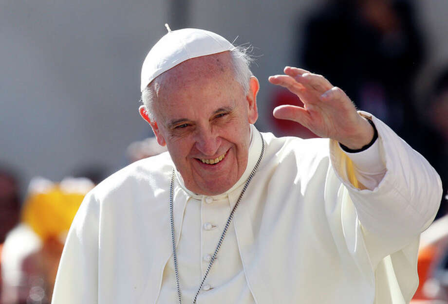 Pope Francis waves to faithful as he arrives for his weekly general audience in St. Peter's Square at the Vatican, Wednesday, Sept. 18, 2013. (AP Photo/Riccardo De Luca) / AP