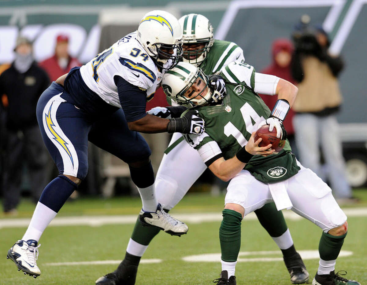 New York Jets quarterback Greg McElroy, right, is sacked by San Diego Chargers defensive end Corey Liuget, left, during the second half of an NFL football game on Sunday, Dec. 23, 2012, in East Rutherford, N.J. The Chargers won 27-17. (AP Photo/Bill Kostroun)