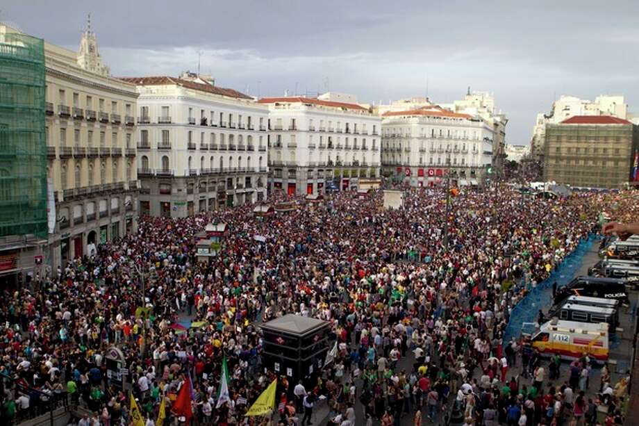 FILE - In this May 12, 21012 file photo, protesters pack the Puerta del Sol plaza in central Madrid. Worldwide growth was slack again in 2012. The global economy grew just 3.3 percent, down from 3.8 percent in 2011 and 5.1 percent in 2010, the International Monetary Fund estimates. (AP Photo/Paul White, File) / 2012 A