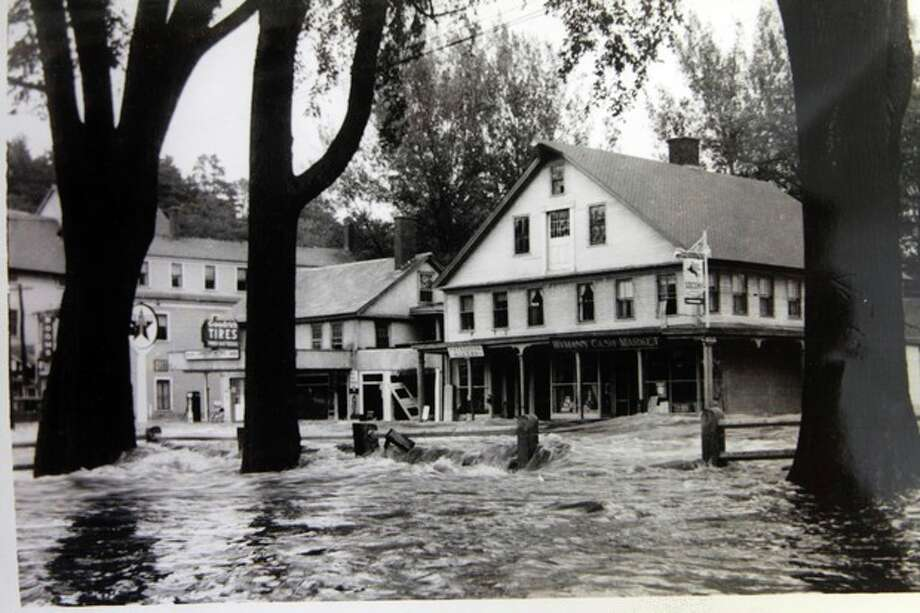 In this photo from the collection of the Monadnock Center for History and Culture, shows flood waters in the center of town in Peterborough, N.H. during the Great New England Hurricane of 1938. Sept. 21, 1938, Seventy-five years ago the hurricane was estimated to have killed between 682 and 800. It remains the most powerful and deadliest hurricane in recent New England history. (AP Photo/Monadnock Center for History and Culture) / Monadnock Center for History and Culture