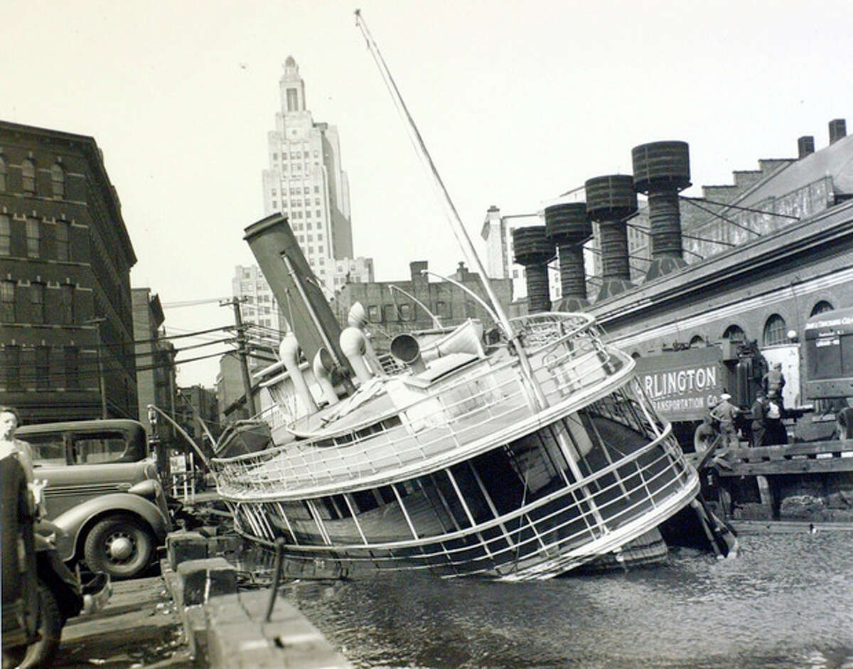 FILE - This September 1938 photo shows a damaged ferry boat sitting in shallow water in Providence, R.I., following the deadly hurricane of 1938 that hit the Northeast. The Great New England Hurricane of 1938 hit the New England Coast 75-years ago Sept. 21.(AP Photo/Boston Public Library, Leslie Jones/FILE)