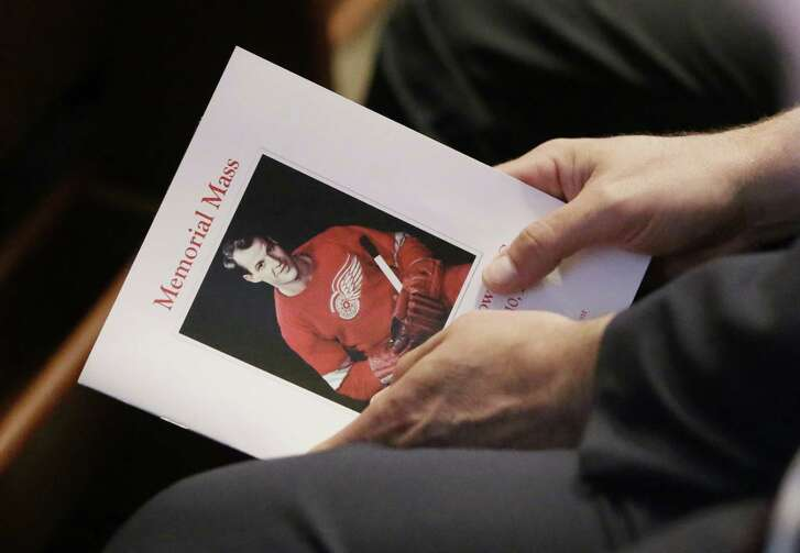 An attendee holds a program for the funeral service of Gordie Howe at the Cathedral of the Most Blessed Sacrament in Detroit.