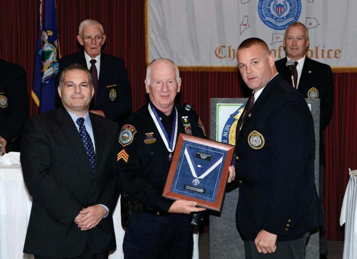 Wilton Police Sgt. Thomas Tunney received the 2013 Medal of Valor for his heroic efforts in pulling a man from a burning vehicle.
