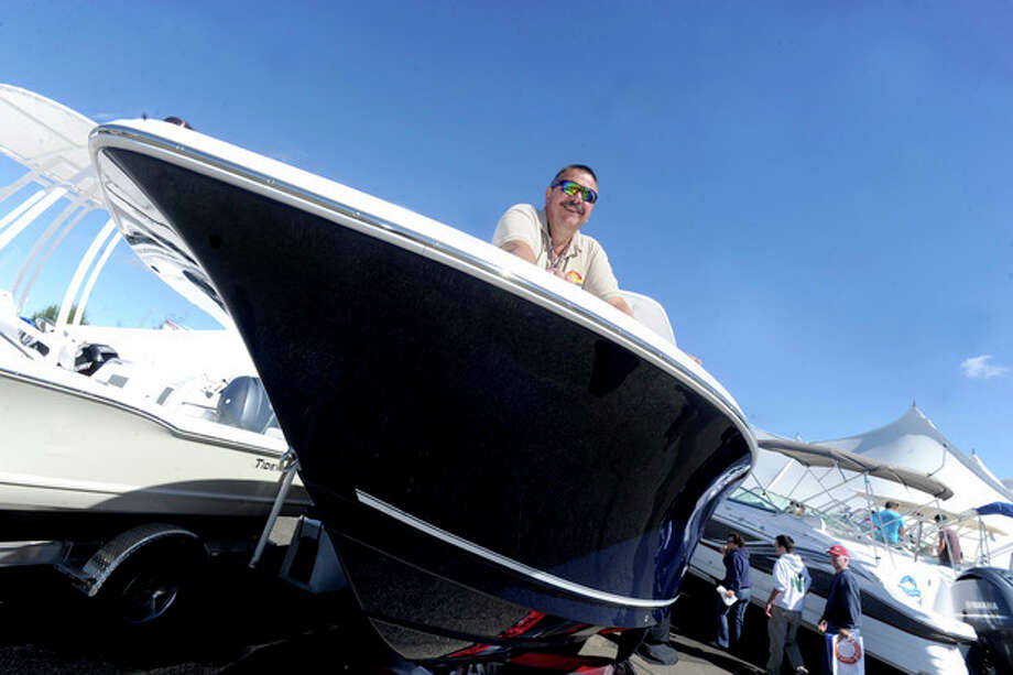 Jeffrey Slater, parts manager at Norwest Marine in Norwalk, sits atop a 23-foot Tidewater at the 2012 Norwalk Boat Show. The Progressive Insurance Norwalk Boat Show returns this week to Norwalk Cove Marina. The annual event attracts upwards of 20,000 visitors.