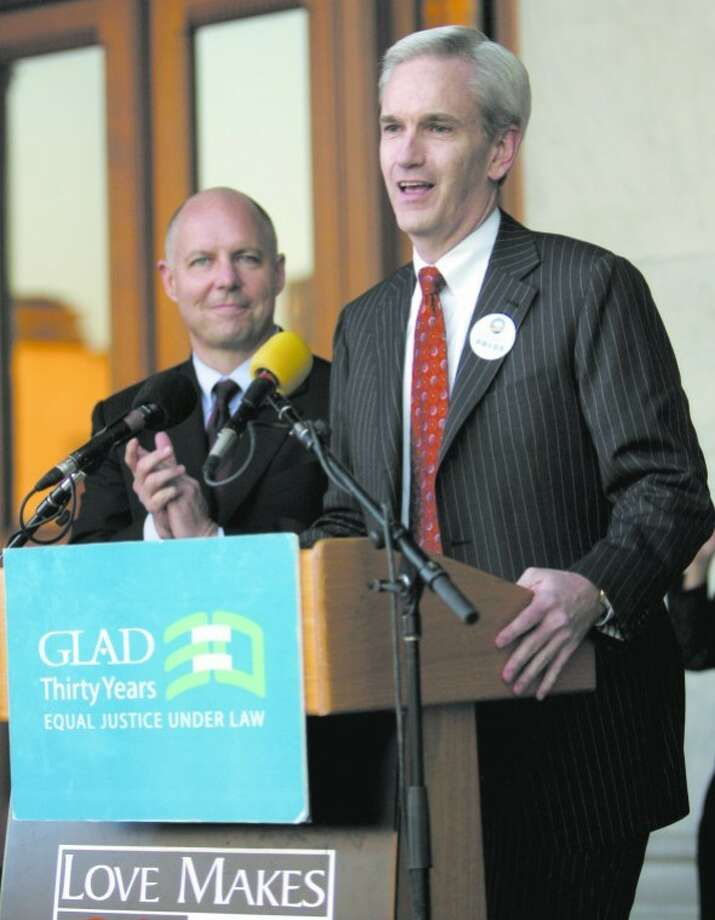 Connecticut State Sen. Andrew McDonald, D-Stamford, speaks at a rally at the State Capitol in Hartford, Conn., Friday, Oct. 10, 2008 celebrating a ruling by the Connecticut Supreme Court favoring gay marriage. Looking on is Connecticut state Rep. Michael Lawlor, D-East Haven. (AP Photo/Bob Child)