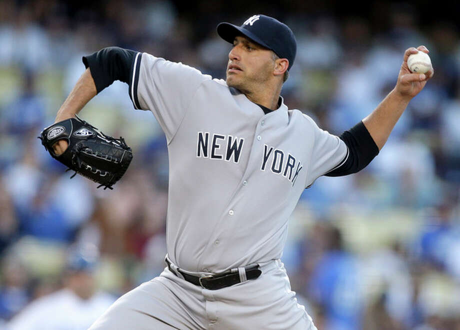 FILE - In this July 30, 2013, file photo, New York Yankees starting pitcher Andy Pettitte throws to the Los Angeles Dodgers during first inning of a baseball game in Los Angeles. Pettitte is retiring from baseball at the conclusion of the season, the Yankees announced on Friday, Sept. 20, 2013. (AP Photo/Chris Carlson, File) / AP