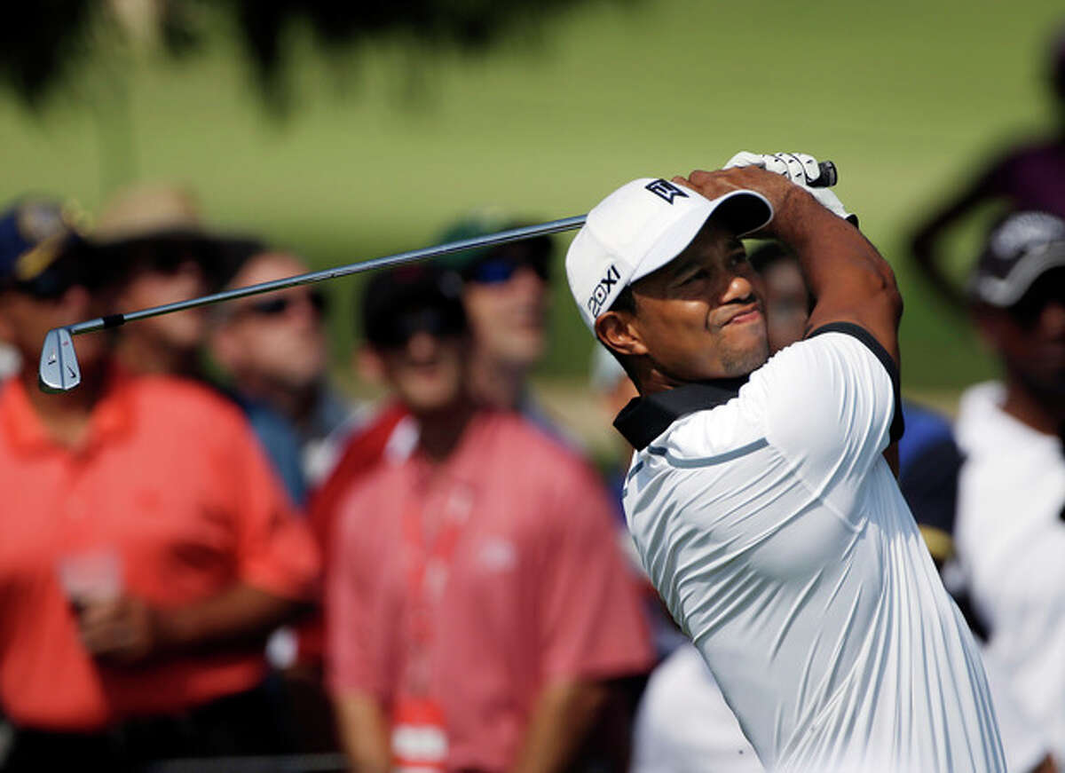 Tiger Woods hits from from the second tee during the second round of the Tour Championship golf tournament at East Lake Golf Club in Atlanta, Friday, Sept. 20, 2013. (AP Photo/John Bazemore)