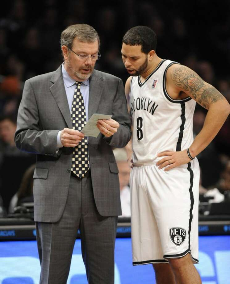 Brooklyn Nets interim head coach P.J. Carlesimo talks with Deron Williams (8) on the sidelines in the first half of an NBA basketball game against the Charlotte Bobcats on Friday, Dec., 28, 2012 at Barclays Center in New York. (AP Photo/Kathy Kmonicek)