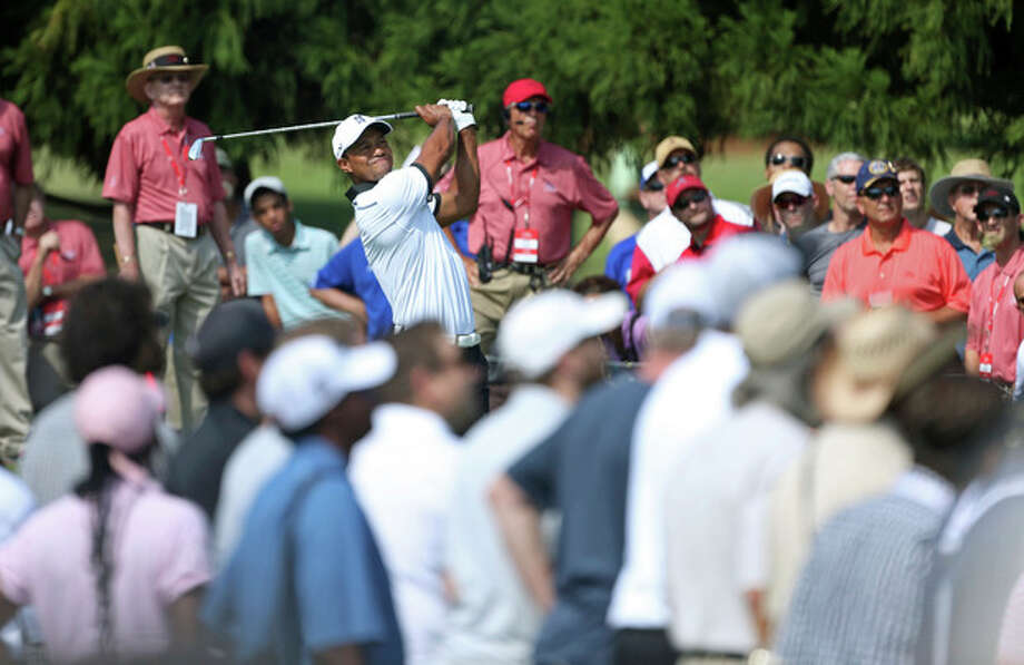 Tiger Woods hits from the the second tee during the second round of the Tour Championship golf tournament at East Lake Golf Club in Atlanta, Friday, Sept. 20, 2013. (AP Photo/Atlanta Journal-Constitution, Jason Getz) MARIETTA DAILY OUT; GWINNETT DAILY POST OUT; LOCAL TV OUT; WXIA-TV OUT; WGCL-TV OUT / AJC